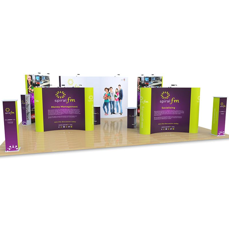 8m x 10m Jumbo S Shape backdrop, with double sided Jumbo Pop Ups, Pop Up Islands, Promo towers, Brandon leaflet dispenser, Rockport counters and Pop Up lights