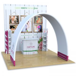 3m x 3m modular exhibition stand wall with counter, leaflet dispensers and fabric arch display