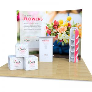 3m x 3m fabric exhibition stand includes fabric curved backdrop with foam cubes, Rockport counter and Hexby leaflet dispenser