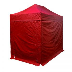 Red outdoor gazebo, with 4 red walls and door way